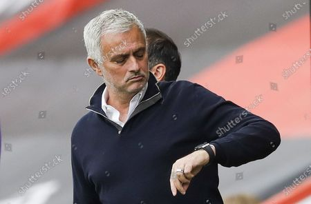 Tottenham Hotspur manager Jose Mourinho looks at his watch ahead of the English Premier League match between AFC Bournemouth and Tottenham Hotspur in Bournemouth, Britain, 09 July 2020.