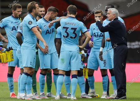 Tottenham Hotspur manager Jose Mourinho (R) talks to his players in a drinking break during the English Premier League match between AFC Bournemouth and Tottenham Hotspur in Bournemouth, Britain, 09 July 2020.