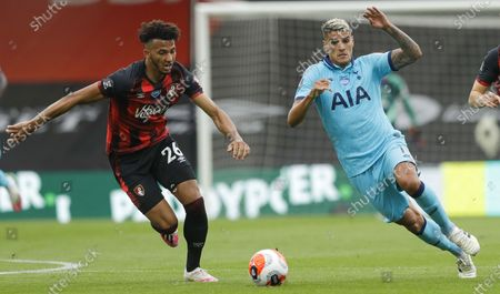 Lloyd Kelly (L) of Bournemouth in action against Erik Lamela (R) of Tottenham during the English Premier League match between AFC Bournemouth and Tottenham Hotspur in Bournemouth, Britain, 09 July 2020.