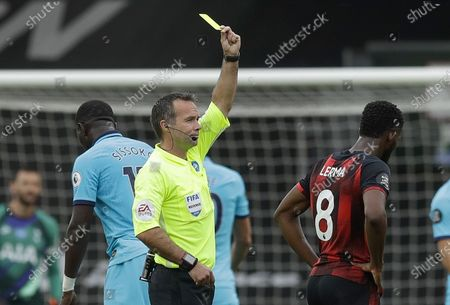 Referee Paul Tierney (C) gives Tottenham Hotspur's Moussa Sissoko (L) and Bournemouth's Jefferson Lerma (R) yellow cards during the English Premier League match between AFC Bournemouth and Tottenham Hotspur in Bournemouth, Britain, 09 July 2020.