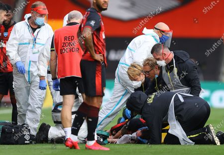 Adam Smith of Bournemouth receives treatment during the English Premier League match between AFC Bournemouth and Tottenham Hotspur in Bournemouth, Britain, 09 July 2020.