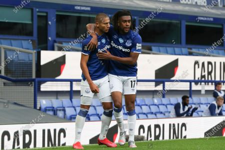 Richarlison of Everton celebrates with Alex Iwobi (R) after scoring a goal during the English Premier League match between Everton and Southampton in Liverpool, Britain, 09 July 2020.
