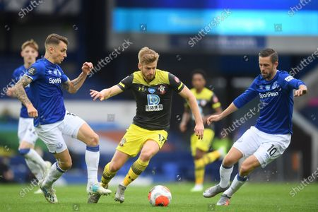 Luccas Digne (L) of Everton in action against Stuart Armstrong (C) of Southampton during the English Premier League match between Everton and Southampton in Liverpool, Britain, 09 July 2020.