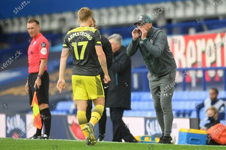 Stuart Armstrong (L) and head coach Ralph Hasenhuettl (R) of Southampton during the English Premier League match between Everton and Southampton in Liverpool, Britain, 09 July 2020.