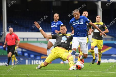 Richarlison (R) of Everton in action against Sam MacQueen (L) of Southampton during the English Premier League match between Everton and Southampton in Liverpool, Britain, 09 July 2020.