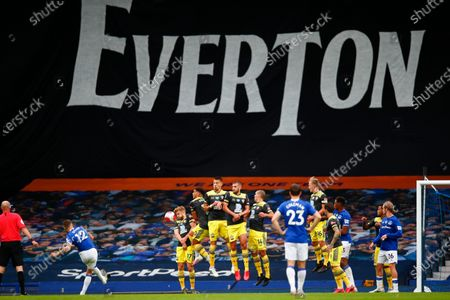 Luccas Digne (L) of Everton in action against Stuart Armstrong (2-L) of Southampton during the English Premier League match between Everton and Southampton in Liverpool, Britain, 09 July 2020.
