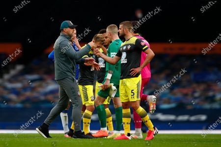 Head coach Raplph Hasenhuettl (L) and Jack Stephens (R) of Southampton after the English Premier League match between Everton and Southampton in Liverpool, Britain, 09 July 2020.