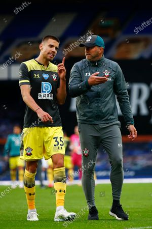 Head coach Ralph Hasenhuettl (R) speaks to Jan Bednarek (L) of Southampton after the English Premier League match between Everton and Southampton in Liverpool, Britain, 09 July 2020.