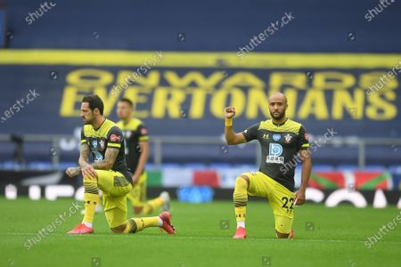 Players take a knee in support of the Black Lives Matter campaign ahead of the English Premier League match between Everton and Southampton in Liverpool, Britain, 09 July 2020.