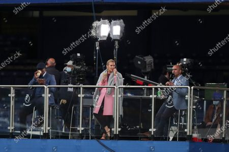 British presenters Gabby Logan (C) and Roberto Martinez (R) during the English Premier League match between Everton and Southampton in Liverpool, Britain, 09 July 2020.