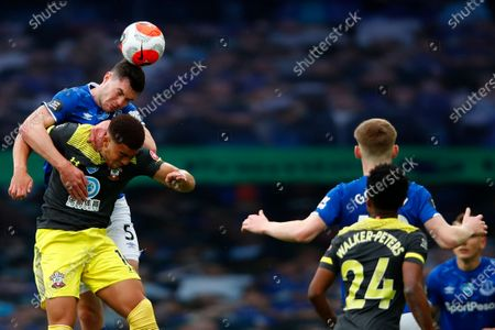 Michael Keane (L) of Everton in action against Che Adams (R) of Southampton during the English Premier League match between Everton and Southampton in Liverpool, Britain, 09 July 2020.
