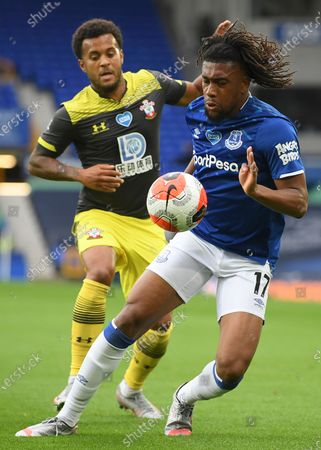 Alex Iwobi (R) of Everton in action against Ryan Bertrand (L) of Southampton during the English Premier League match between Everton and Southampton in Liverpool, Britain, 09 July 2020.