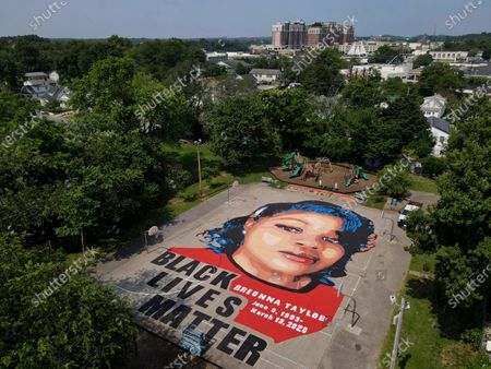 Ground mural depicting a portrait of Breonna Taylor is seen at Chambers Park, in Annapolis, Md. The mural honors Taylor, a 26-year old Black woman who was fatally shot by police in her Louisville, Kentucky, apartment. The artwork was a team effort by the Banneker-Douglass Museum, the Maryland Commission on African American History and Culture, and Future History Now, a youth organization that focuses on mural projects