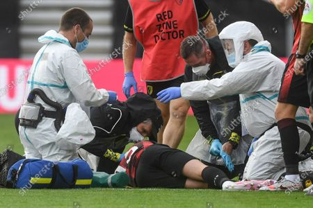 Bournemouth's Adam Smith receives medical attention during the English Premier League soccer match between Bournemouth and Tottenham at the Vitality Stadium in Bournemouth, England
