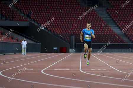 Christophe Lemaitre from France competes in the men's 200m race during the Weltklasse Zurich Inspiration Games, a virtual international athletics meeting at seven venues worldwide, at the Letzigrund stadium in Zurich, Switzerland, 09 July 2020.