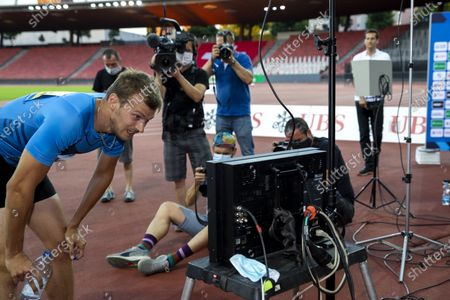 Stock Image of Christophe Lemaitre from France reacts after competing in the men's 200m race during the Weltklasse Zurich Inspiration Games, a virtual international athletics meeting at seven venues worldwide, at the Letzigrund stadium in Zurich, Switzerland, 09 July 2020.