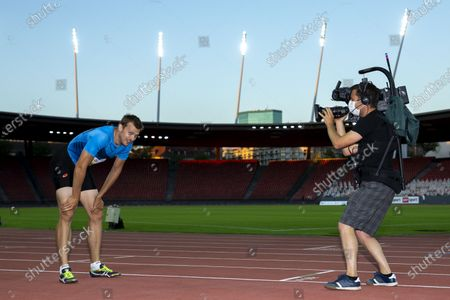 Stock Picture of Christophe Lemaitre from France reacts after competing in the men's 200m race during the Weltklasse Zurich Inspiration Games, a virtual international athletics meeting at seven venues worldwide, at the Letzigrund stadium in Zurich, Switzerland, 09 July 2020.