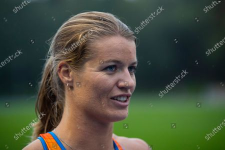 Netherlands' Dafne Schippers smiles after competing in the 3 x 100 meter relay women of the Inspiration Games, the Dutch event of the Weltklasse track meet in Papendal, outside Arnhem, Netherlands, . The traditional Weltklasse track meet is taking on a different look and a different name this year with 30 athletes competing in eight disciplines in a team event spanning seven stadiums on three continents