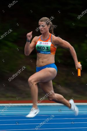 Netherlands' Dafne Schippers competes in the 3 x 100 meter relay women of the Inspiration Games, the Dutch event of the Weltklasse track meet in Papendal, outside Arnhem, Netherlands, . The traditional Weltklasse track meet is taking on a different look and a different name this year with 30 athletes competing in eight disciplines in a team event spanning seven stadiums on three continents
