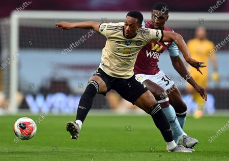 Manchester United's Anthony Martial (L) in action against Aston Villa's Kortney Hause (R), as play resumes behind closed doors following the outbreak of the coronavirus disease (COVID-19) during the English Premier League match between Aston Villa and Manchester United in Birmingham, Britain, 09 July 2020.