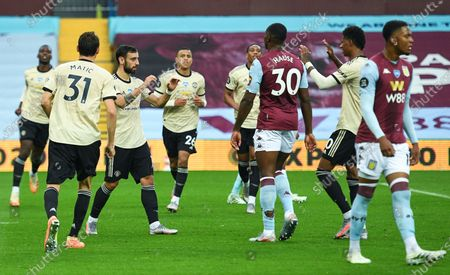 Bruno Fernandes (3-L) of Manchester United celebrates with teammates after scoring the opening goal during the English Premier League match between Aston Villa and Manchester United in Birmingham, Britain, 09 July 2020.