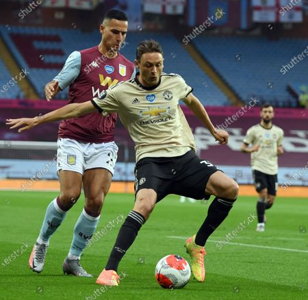 Manchester United's Nemanja Vidic (R) in action against Aston Villa's Anwar El Ghazi (L), as play resumes behind closed doors following the outbreak of the coronavirus disease (COVID-19) during the English Premier League match between Aston Villa and Manchester United in Birmingham, Britain, 09 July 2020.