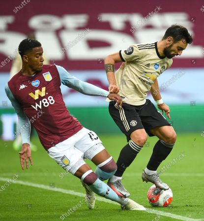 Ezri Konsa (L) of Aston Villa in action against Bruno Fernandes (R) of Manchester United during the English Premier League match between Aston Villa and Manchester United in Birmingham, Britain, 09 July 2020.