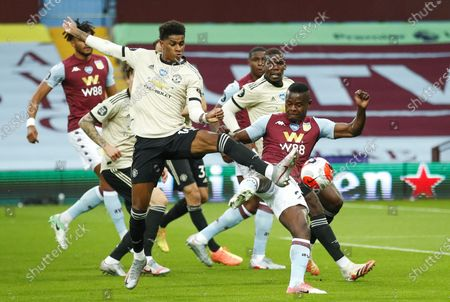 Mbwana Samatta (R) of Aston Villa in action against Marcus Rashford (L) of Manchester United during the English Premier League match between Aston Villa and Manchester United in Birmingham, Britain, 09 July 2020.