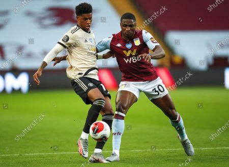 Kortney Hause (R) of Aston Villa in action against Marcus Rashford (L) of Manchester United during the English Premier League match between Aston Villa and Manchester United in Birmingham, Britain, 09 July 2020.