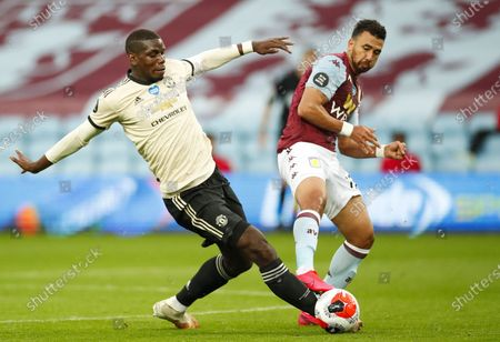 Trezeguet (R) of Aston Villa in action against Paul Pogba (L) of Manchester United during the English Premier League match between Aston Villa and Manchester United in Birmingham, Britain, 09 July 2020.