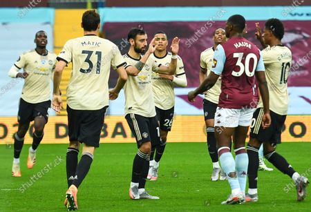 Bruno Fernandes (3-L) of Manchester United celebrates with teammates after scoring opening goal during the English Premier League match between Aston Villa and Manchester United in Birmingham, Britain, 09 July 2020.