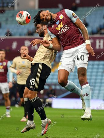Tyrone Mings (R) of Aston Villa in action against Bruno Fernandes (L) of Manchester United during the English Premier League match between Aston Villa and Manchester United in Birmingham, Britain, 09 July 2020.