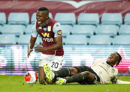 Mbwana Samatta (L) of Aston Villa in action against Aaron Wan-Bissaka (R) of Manchester United during the English Premier League match between Aston Villa and Manchester United in Birmingham, Britain, 09 July 2020.