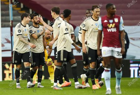Bruno Fernandes (2-L) of Manchester United celebrates with teammates after scoring opening goal during the English Premier League match between Aston Villa and Manchester United in Birmingham, Britain, 09 July 2020.