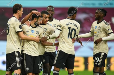 Bruno Fernandes (2-L) of Manchester United celebrates with teammates after scoring the opening goal during the English Premier League match between Aston Villa and Manchester United in Birmingham, Britain, 09 July 2020.