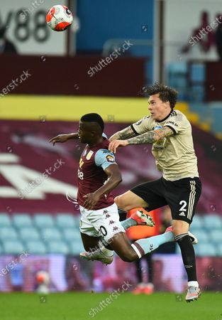 Aston Villa's Mbwana Samatta (L) in action against Manchester United's Victor Lindelof,(R) during the English Premier League match between Aston Villa and Manchester United in Birmingham, Britain, 09 July 2020.