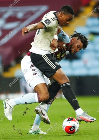 Aston Villa's English Tyrone Mings (back) in action against Manchester United's  Anthony Martial (front) during the English Premier League match between Aston Villa and Manchester United in Birmingham, Britain, 09 July 2020.