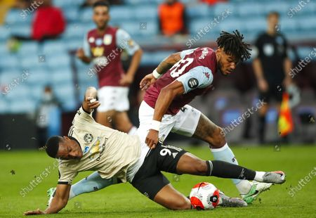 Aston Villa's English Tyrone Mings (R) in action against Manchester United's  Anthony Martial (L) during the English Premier League match between Aston Villa and Manchester United in Birmingham, Britain, 09 July 2020.
