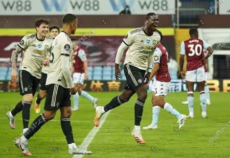 Paul Pogba (R) of Manchester United celebrates after scoring the 3-0 lead during the English Premier League match between Aston Villa and Manchester United in Birmingham, Britain, 09 July 2020.