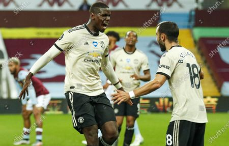 Paul Pogba (L) of Manchester United celebrates with teammate Bruno Fernandes (R) after scoring the 3-0 lead during the English Premier League match between Aston Villa and Manchester United in Birmingham, Britain, 09 July 2020.