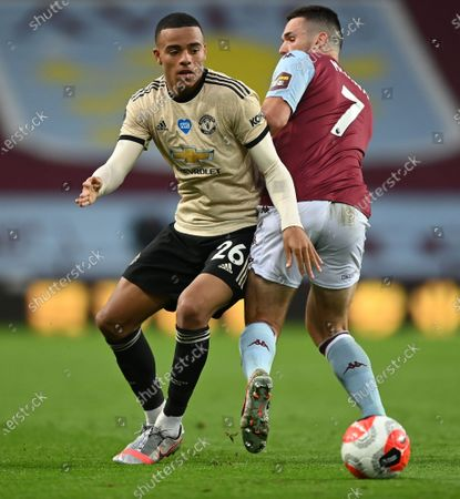 Mason Greenwood (L) of Manchester United in action against John McGinn (R) of Aston Villa during the English Premier League match between Aston Villa and Manchester United in Birmingham, Britain, 09 July 2020.