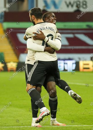 Paul Pogba (back) of Manchester United celebrates with teammate Bruno Fernandes (front) after scoring the 3-0 lead during the English Premier League match between Aston Villa and Manchester United in Birmingham, Britain, 09 July 2020.