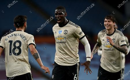 Manchester United's Paul Pogba (C) celebrates after scoring his team's third goal with teammates Bruno Fernandes (L) and Victor Lindelof (R) during the English Premier League football match between Aston Villa and Manchester United at Villa Park in Birmingham, central England on July 9, 2020.during the English Premier League match between Aston Villa and Manchester United in Birmingham, Britain, 09 July 2020.