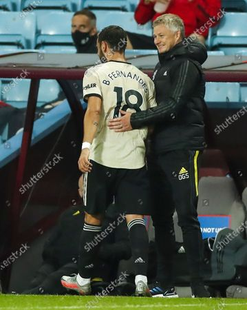 Manchester United Manager Ole Gunnar Solskjaer (R) hugs his player Bruno Fernandes (L) during the English Premier League match between Aston Villa and Manchester United in Birmingham, Britain, 09 July 2020.