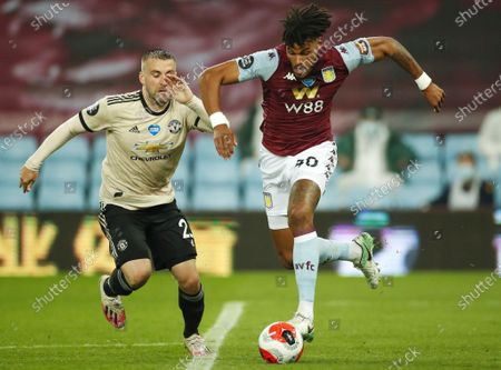 Tyrone Mings (R) of Aston Villa in action against Luke Shaw (L) of Manchester United during the English Premier League match between Aston Villa and Manchester United in Birmingham, Britain, 09 July 2020.