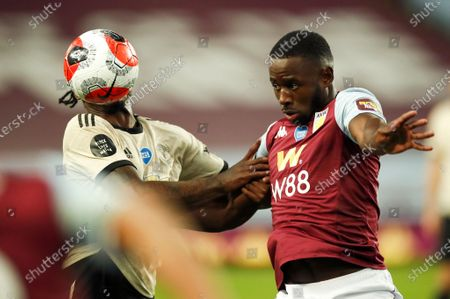 Manchester United's Aaron Wan-Bissaka (L) in action against Aston Villa's Keinan Davis (R) during the English Premier League match between Aston Villa and Manchester United in Birmingham, Britain, 09 July 2020.