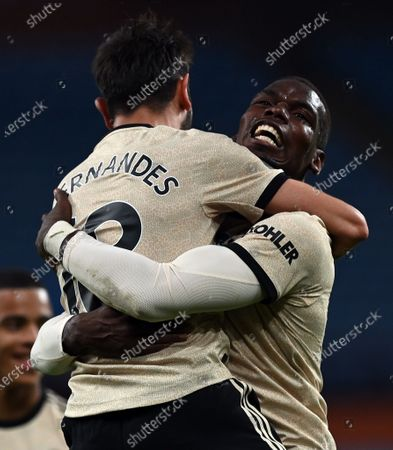 Manchester United's Paul Pogba (R) celebrates after scoring his team's third goal with teammate Bruno Fernandes (L) during the English Premier League football match between Aston Villa and Manchester United at Villa Park in Birmingham, central England on July 9, 2020.during the English Premier League match between Aston Villa and Manchester United in Birmingham, Britain, 09 July 2020.