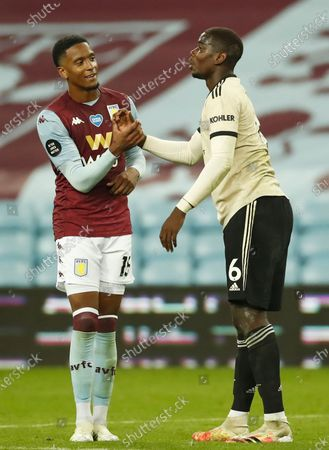 Ezri Konsa (L) of Aston Villa hand shakes with Paul Pogba (R) of Manchester United during the English Premier League match between Aston Villa and Manchester United in Birmingham, Britain, 09 July 2020.