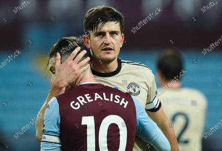 Harry Maguire of Manchester United hugs Jack Grealish (L) of Aston Villa after the English Premier League match between Aston Villa and Manchester United in Birmingham, Britain, 09 July 2020.