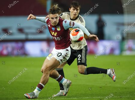 Jack Grealish (L) of Aston Villa in action against Victor Lindelof (R) of Manchester United during the English Premier League match between Aston Villa and Manchester United in Birmingham, Britain, 09 July 2020.